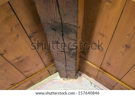 Wooden ceiling and pink wall. Small room ceiling - stock photo