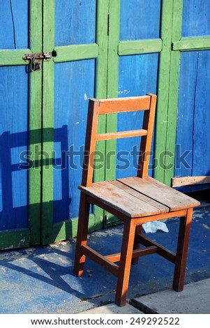 wooden chair at grunge door