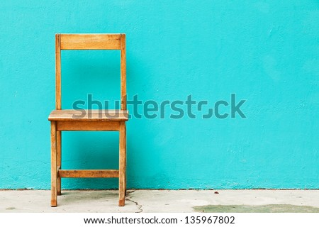 Wooden Chair in Abandoned Building - stock photo
