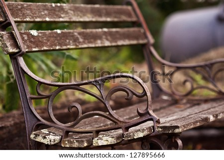 Wooden chair in the park outdoors - stock photo