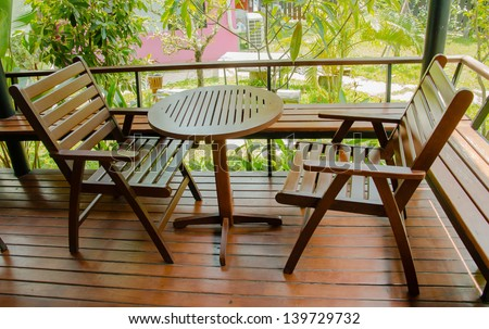 Wooden chair on a balcony in the garden.