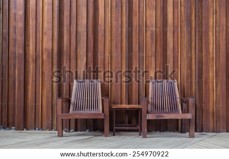 wooden chair on the  in front of the wall wood - stock photo