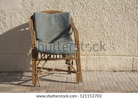 Wooden chair with hassock