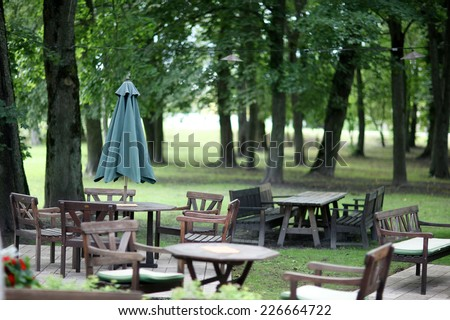 Wooden chairs and table of park cafe - stock photo