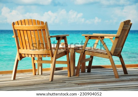 Wooden chairs by the sea