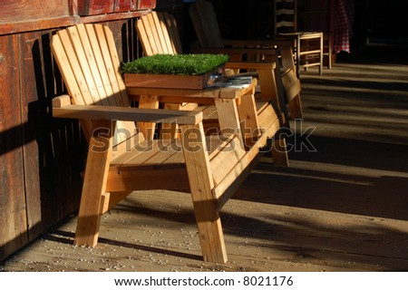 Wooden chairs lit by late afternoon sun; Oak Glen, California
