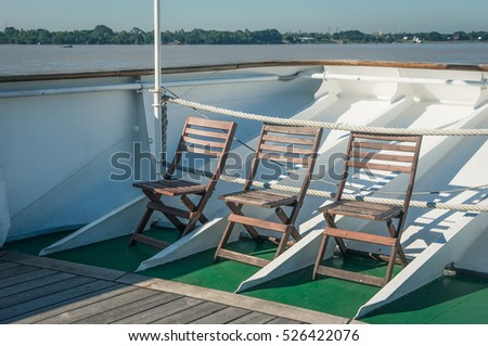 Wooden chairs on a cruise