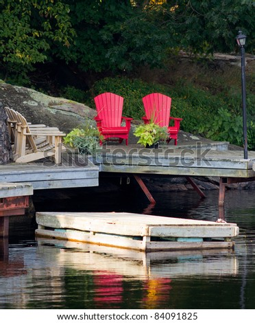 Wooden chairs on a dock - stock photo