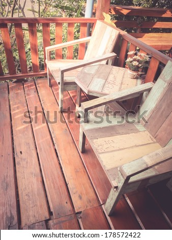 wooden chairs on a patio, retro filter effect - stock photo