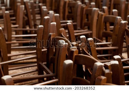 wooden chairs stacked