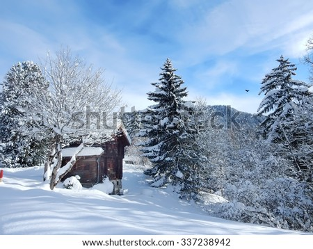 Wooden chalet cottage in winter, Swiss Alps, Switzerland
