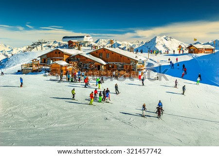 Wooden chalets and ski slopes in the French Alps,Les 3 Vallees,Menuires,France,Europe - stock photo