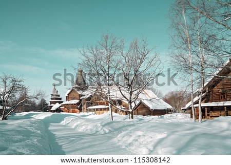 wooden chapel in winter village - stock photo
