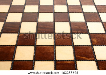 Wooden chess board, for backgrounds or textures - stock photo
