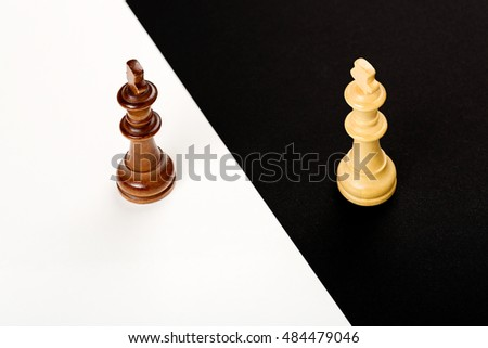 wooden chess kings on black and white, abstract concept