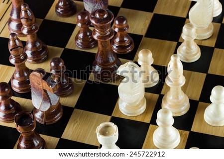 Wooden chess on chess board - stock photo