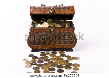 Wooden chest with coins - stock photo