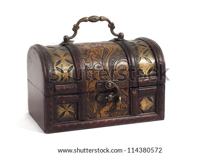 wooden chest with golden ornaments isolated on white background