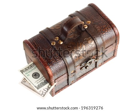 Wooden chest with money isolated on the white background - stock photo