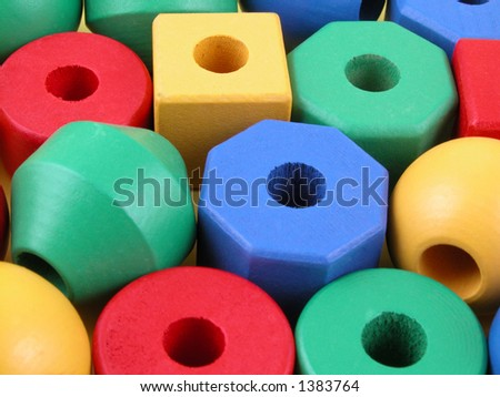 wooden childrens blocks of different colors - background - stock photo