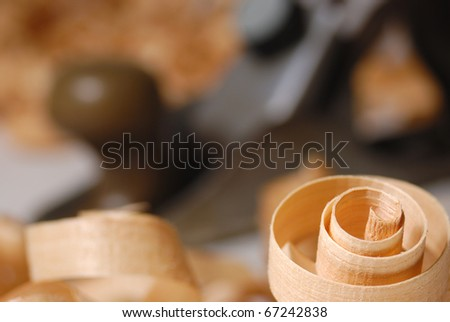 Wooden chips and plane over blurry background - stock photo