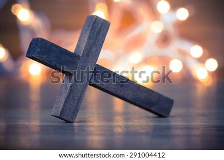 Wooden Christian Cross with a soft bokeh lights background - stock photo