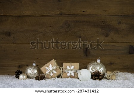 Wooden christmas background with decoration like presents, balls and snow. - stock photo