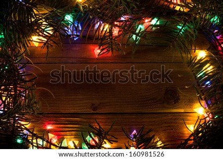 wooden christmas background with multicolored lights