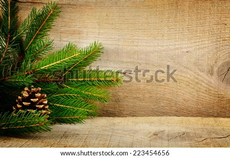 Wooden christmas background with spruce with pine cone - stock photo