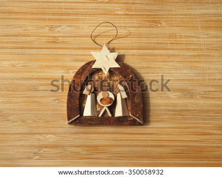 Wooden christmas creche on a wooden background - stock photo