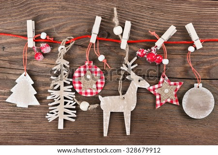 Wooden christmas decoration - christmas ball, deer, tree and star - stock photo