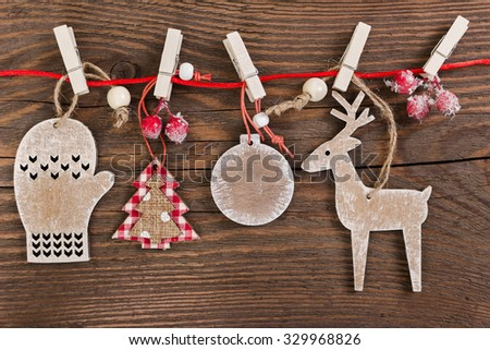 Wooden christmas decoration on wooden background - christmas ball, deer, tree, mitten and star - stock photo