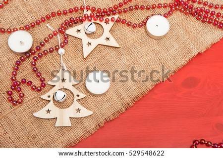 Wooden Christmas decorations on canvas