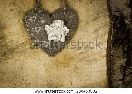 wooden Christmas heart with angel inside and heart  on the wooden birch background - stock photo