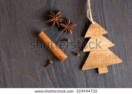Wooden christmas tree on wooden background and anise  - stock photo