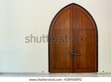 Wooden church door with wood lock - stock photo