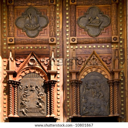 Wooden Church Doors with Metal Religious and Mexican Symbols and Decorations, Temple Expiatorio, Temple of Atonement, Guadalajara, Mexico - stock photo