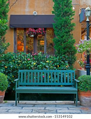 Wooden classic chair in garden - stock photo