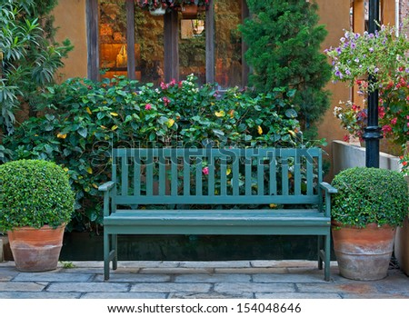 Wooden classic chair in garden - stock photo