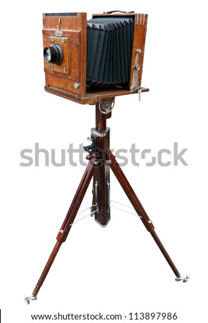 Wooden classic retro camera on tripod. Clipping path included. - stock photo