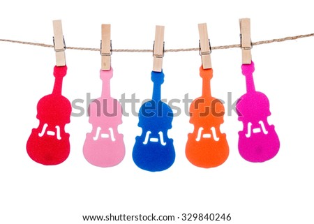 wooden clip on a  twine , hanging colorful  Guitar Violin music - stock photo