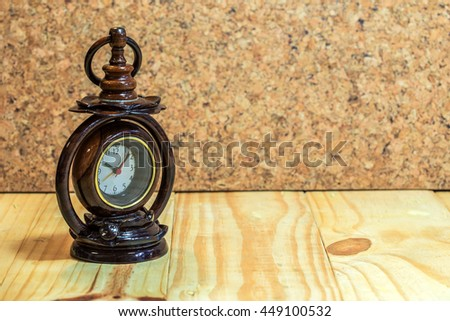 Wooden clock on wood table and wood background. - stock photo