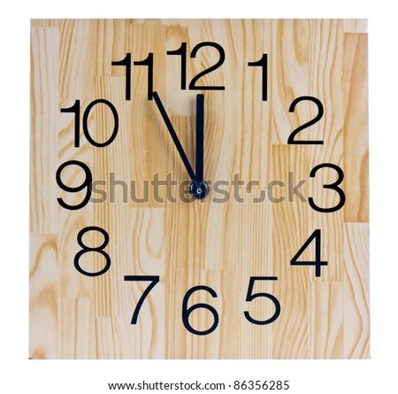 Wooden clock saying five to twelve - stock photo