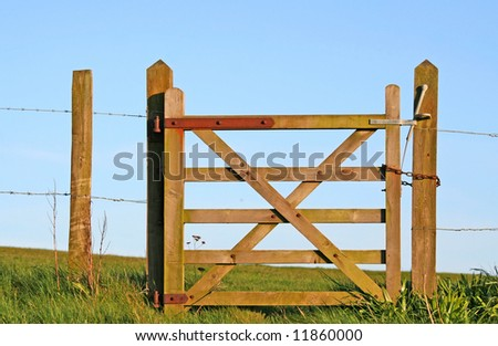 Wooden closed gate in the countryside - stock photo