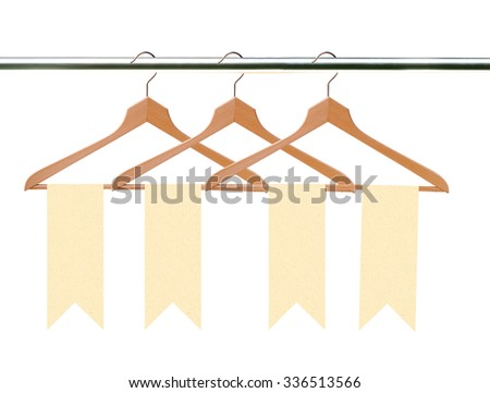 wooden clothes hangers with tags (labels) isolated on white - stock photo