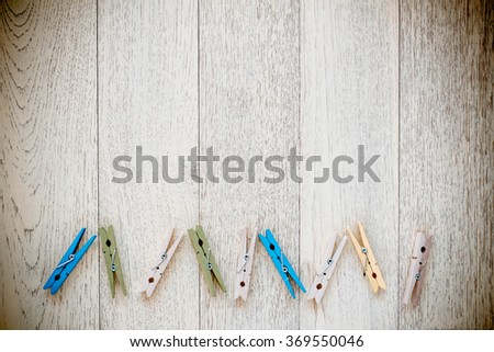 Wooden Clothespin on old wood background. Vintage Style. - stock photo