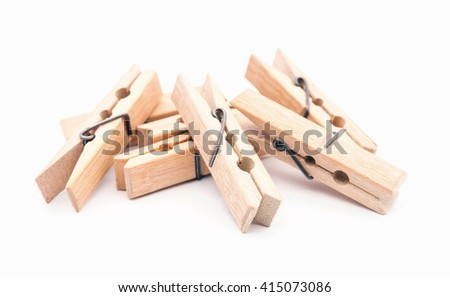 wooden clothespins on white - stock photo