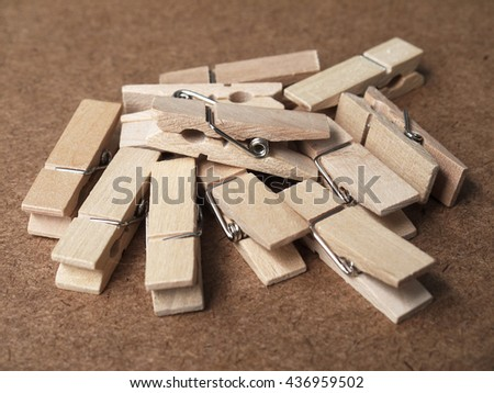 Wooden clothespins on wood table - stock photo