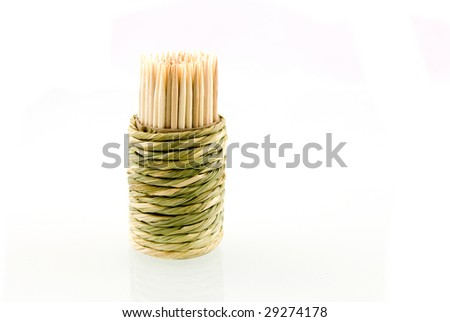 Wooden cocktail picks isolated on white background