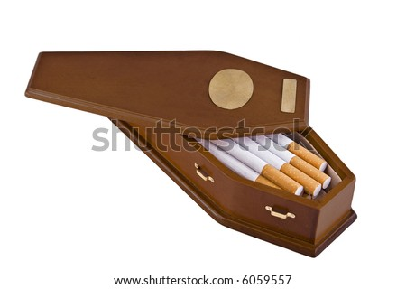 Wooden coffin containing cigarettes.  This is a conceptual image for the perils of smoking or quitting smoking.  The casket has brass handles and two brass plates, perfect for adding text. - stock photo